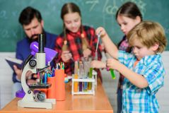 Back to school. Educational concept. children scientists making experiments in laboratory. Pupils in the chemistry class royalty free stock photo