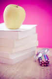 Back to school essentials: books, pencils, snack Stock Photos