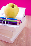 Back to school essentials: books, pencils, snack Royalty Free Stock Photos