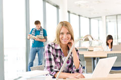 Back to school - female student with laptop. Back to school - female student in classroom with laptop Stock Images