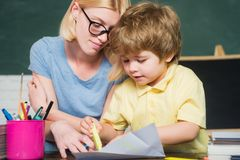 Back to school. Female teacher and schoolboy in class at school. Teacher and child. royalty free stock images