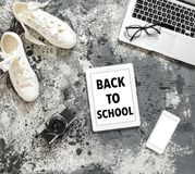 Back to school flat lay Laptop camera mobile phone shoes. Back to school flat lay. Laptop computer camera mobile phone shoes Royalty Free Stock Image