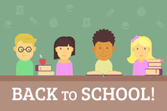 Back to school. Four cute children with books sitting in the classroom. Text back to school outlined Stock Images