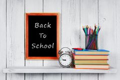 Back to school. Frame. Books and school tools. Royalty Free Stock Image