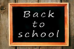 Back to school. The frame on wooden background. Stock Photo