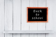 Back to school. Frame and wooden shelf. Stock Photos