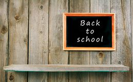 Back to school. Frame and a wooden shelf. Stock Photo