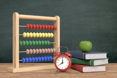 Back to school. Front view of a vintage alarm clock, an abacus with text: back to school and a stack of books, chalkboard on background with empty space 3d Royalty Free Stock Image