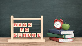 Back to school. Front view of a vintage alarm clock, an abacus with text: back to school and a stack of books, chalkboard on background with empty space 3d Stock Photography