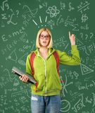 Back to school. Funny female young teacher in the classroom. Mark for exam. Back to school. Funny female young teacher in the classroom. Mark for exam royalty free stock photography