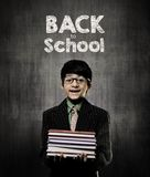 Back To School. Genius Little Boy Holding Books Wearing Glasses Royalty Free Stock Photography