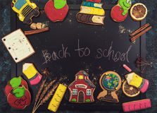 Back to school gingerbreads. Cookies on a dark background Stock Image