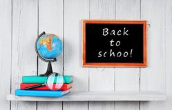 Back to school. The globe and books . Stock Photos