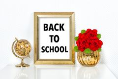 Back to school Golden picture frame decorations. Back to school. Golden picture frame with decorations. Vase and globe no name products Royalty Free Stock Photos