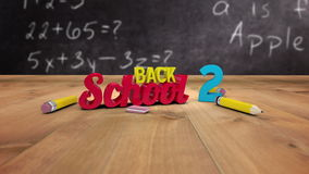Back to school graphic falling in classroom. Digital animation of Back to school graphic falling in classroom stock footage