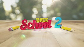Back to school graphic falling with pencils. Digital animation of Back to school graphic falling with pencils stock video