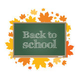 Back to school. Green board on a background of autumn maple leaves. Royalty Free Stock Images
