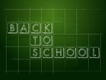 Back to school on green checkered chalkboard Royalty Free Stock Images