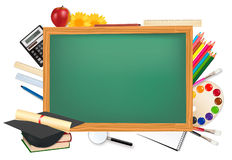 Back to school. Green desk with school supplies. Stock Image