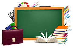 Back to school. Green desk with school supplies. Stock Photography