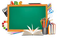 Back to school. Green desk with school supplies. Stock Images