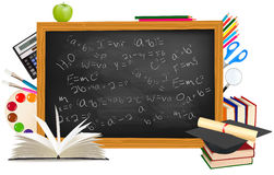 Back to school. Green desk with school supplies. Stock Photos