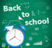 Back to school, green school background with alarm clock Stock Photography