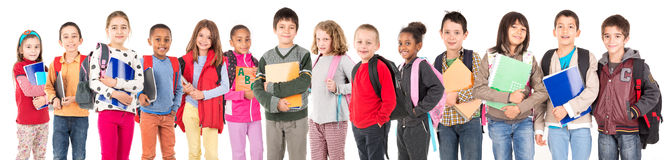 Back to school. Group of school children posing isolated in white Royalty Free Stock Photo