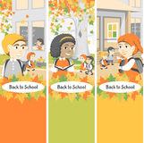 Back to school. Group of happy students walking in the school yard. Autumn day Royalty Free Stock Photos