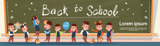 Back To School Group Of Small Pupils Girls And Boys Standing Over Class Board Schoolgirl And Schoolboy Education Banner Royalty Free Stock Photos