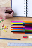 Back to school. Hand with Colorful Office and study art statione Royalty Free Stock Photos