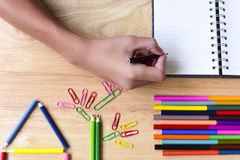 Back to school. Hand with Colorful Office and study art statione Royalty Free Stock Image