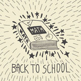 Back to school hand drawn doodle card with math textbook. Back to school hand drawn doodle card with mathematics textbook. The math book on beige background Stock Photography