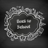 Back to school hand drawn doodles on a chalkboard. Education background. Hand drawn school supplies. Vector Stock Photo