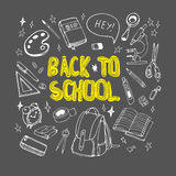 Back to school hand drawn illustration. Set of school supplies drawn on chalkboard. Back to school hand drawn illustration. Set of school supplies drawn on Stock Photography