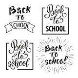 Back to school hand drawn lettering. Blackboard background with colorful pencils. Knowledge Day. Stock Photos