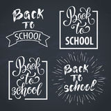 Back to school hand drawn lettering. Blackboard background with colorful pencils. Knowledge Day. Stock Photography