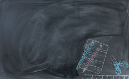 Back to school hand drawn materials on erased chalkboard. Back to School concept with erased chalk board and hand drawn supplies Stock Photography