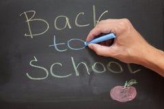 Back to School. Hand writes  on a blackboard Stock Photos