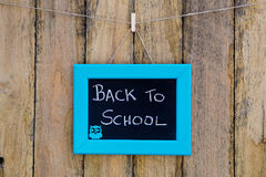 Back to School hand written in chalk on blackboard with blue fra Stock Image