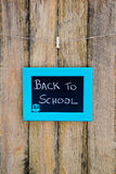 Back to School hand written in chalk on blackboard with blue fra Royalty Free Stock Images