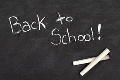 Back To School handwritten in chalk on blackboard Royalty Free Stock Image