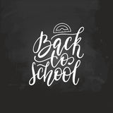 Back To School handwritten illustration with protractor drawing on chalkboard. Vector hand lettering. Stock Photo