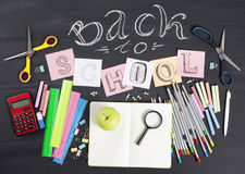 `Back to school` handwritten with school supplies on a black background. Top view. `Back to school` handwritten with school supplies on a black background. Top Stock Images