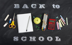 `Back to school` handwritten with school supplies on a black background. Top view. `Back to school` handwritten with school supplies on a black background. Top Royalty Free Stock Photography