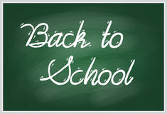Back to school handwritten with white chalk on a green school board. Vector illustration of words Back to school handwritten with white chalk on a green school Stock Photography