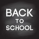 Back to school handwritten with white chalk on a school blackboa. Vector illustration of words Back to school handwritten with white chalk on a school blackboard Royalty Free Stock Images