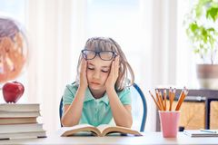 Kid is learning in class. Royalty Free Stock Photography