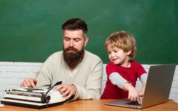 Back to school. Happy family - daddy and son together. Daddy play with schoolboy. Teacher teaches a student to use a stock photography