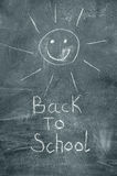 Back to school and happy sun on chalkboard Stock Photo